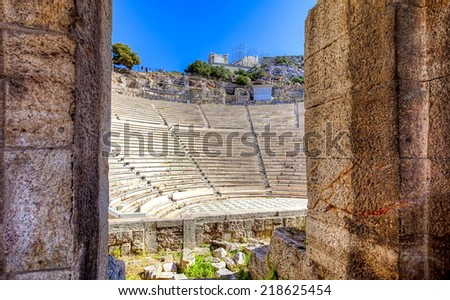 The Odeon of Herodes Atticus on the southwest slope of the Acropolis of Athens in Greece - stock photo