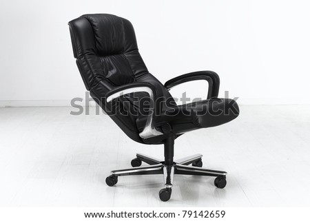 The office chair from black imitation leather. Isolated - stock photo