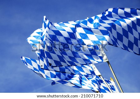 The official Flags of Bavaria waving over the Oktoberfest in Munich.  - stock photo