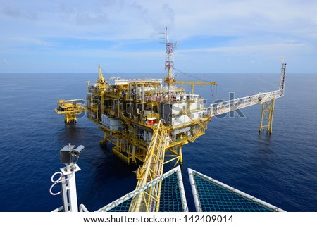 The offshore oil rig drilling platform - stock photo