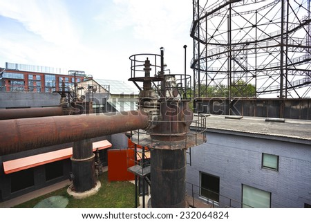 The old abandoned closed steel steelworks of pipelines - stock photo