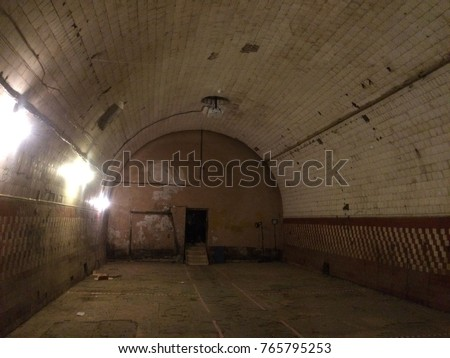Old abandoned lowlighted building vaulted ceilings stock photo the old abandoned low lighted building with vaulted ceilings is a view from the inside mozeypictures Images