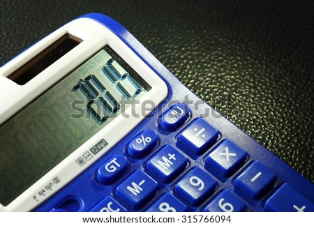 The old and dirty blue color calculator represent the calculation equipment and new year concept related idea.