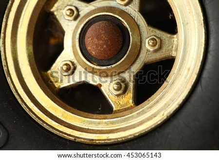 The old and dirty plastic wheel of toy car model represent the texture surface and car part background concept related idea.