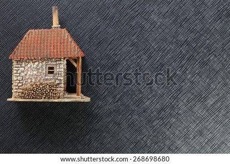 The old and vintage rural style of miniature plastic model farmhouse represent the mortgage concept related idea. - stock photo