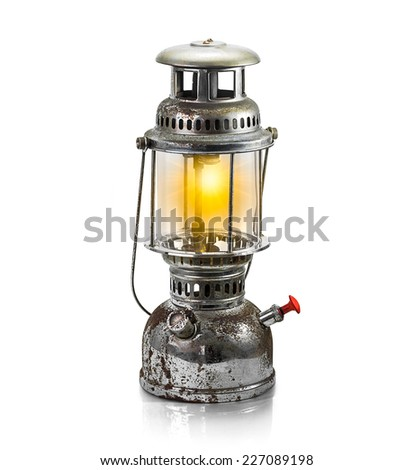 The old antique storm lantern isolated on white - stock photo