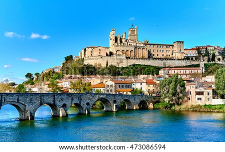 The old Arch Bridge and Cathedral Saint-Nazaire in the Beziers town. Cathedral is the largest Gothic monument in the city. Built in the XIV century, It's a symbol of the city. France