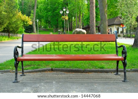 The old bench on the promenade in the park - stock photo