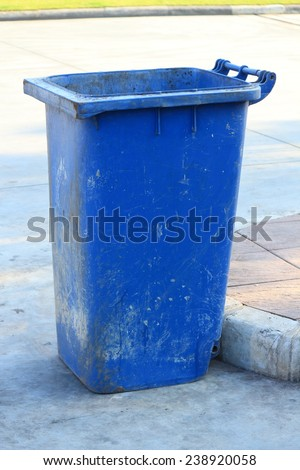The old blue garbage cans on the street