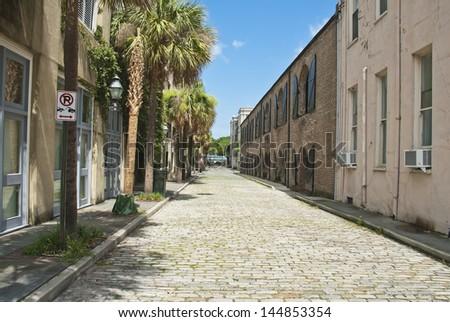 The old brick paved Mid Atlantic Wharf Street in Charleston, South Carolina. - stock photo