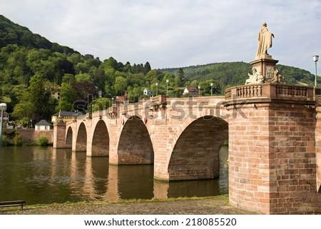 The Old Bridge across the Neckar river in Heidelberg, Germany, in warm afternoon sunlight - stock photo