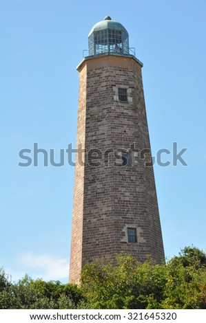 The old Cape Henry lighthouse at Fort Story in Virginia Beach, Virginia - stock photo