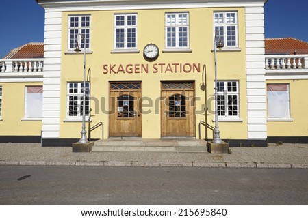 The old Central Station at Skagen (Denmark, North Jutland) is built in the typical architectural style and colors with ochraceous walls, a red roof and white joints. - stock photo