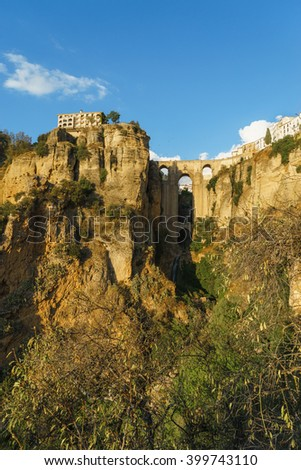 The old city of Ronda, one of the famous white villages, at sunset in the province of Malaga, Andalusia, Spain - stock photo