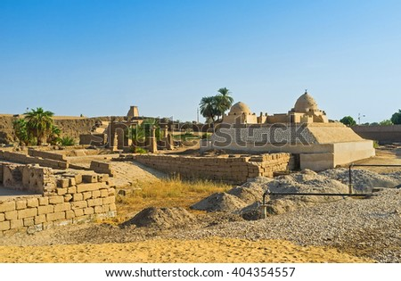 The old clay mosque among the ancient ruins, located in front of the Karnak Temple, Luxor, Egypt.