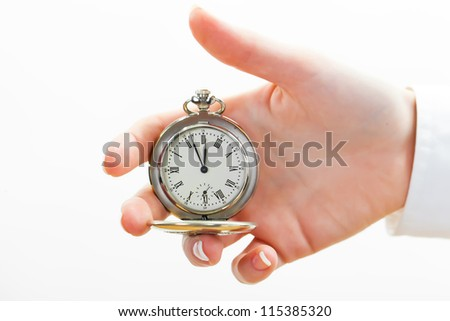 The old clock in female hands isolated - stock photo