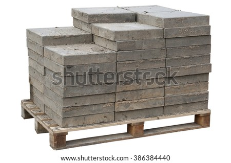 The old concrete paving blocks  are accurately put on wooden  pallet. Isolated. After repair of the sewerage the tile will be put on the place. - stock photo