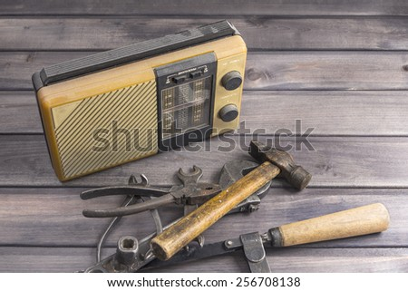 the old dirty radio receiver old tools on wooden boards a zone to focusing on the radio receiver white balance  special toning - stock photo