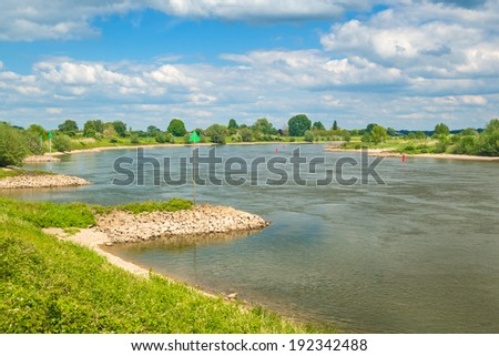 The old Dutch river IJssel between the cities of Zutphen and Deventer - stock photo