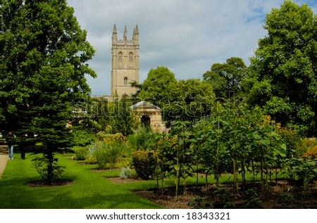 The old English garden in Oxford with castle on the background