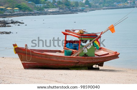 The Old fishing boat on sand beach