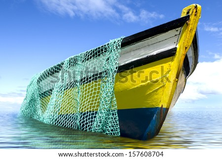 The old fishing boat with fishing net - stock photo