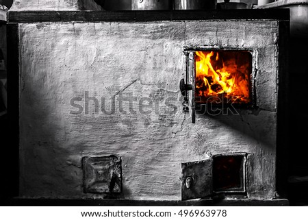 the old furnace in the house and the flames
