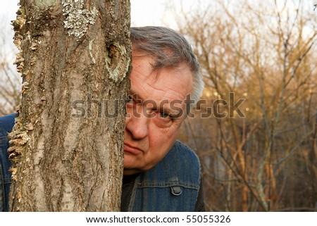 The old gardener working in the spring garden - stock photo