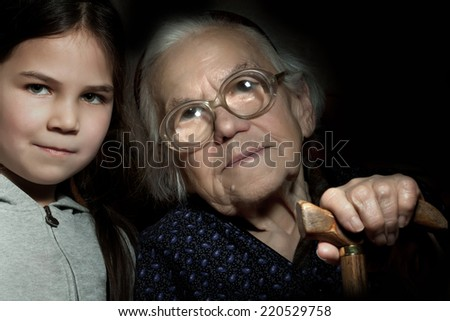 The old grandmother and her young cute grandchild - stock photo