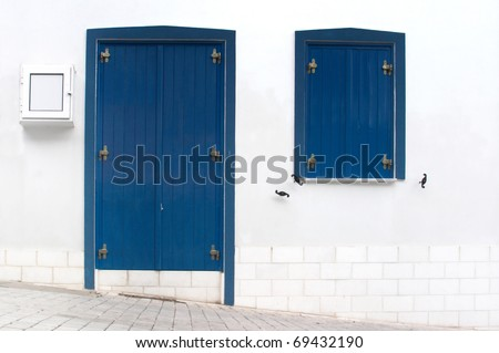 The old Greek houses with blue doors and windows
