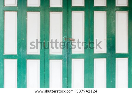 The old grunge folding door closed. - stock photo
