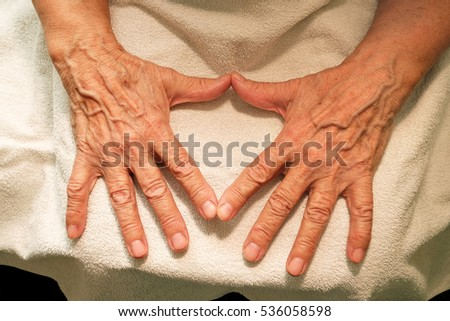 The old hands beloved grandmother on a terry towel