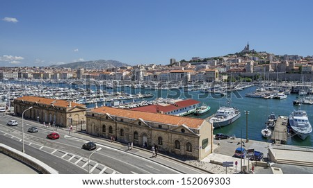 "The old harbor ""Vieux Port"" and the church ""Notre Dame de la Garde"" of Marseille in France"