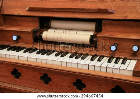 The old harpsichord with keyboard and notes. - stock photo