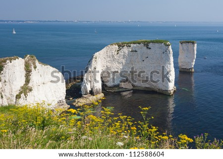 The Old Harry Rocks are chalk formations, located at Handfast Point, on the Isle of Purbeck in Dorset, southern England. (With Bournemouth in the background) - stock photo