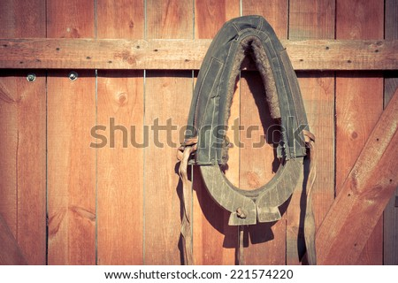 The old horse clamp in the log wooden wall - stock photo