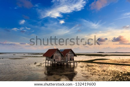 The old house in sunset time - stock photo