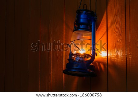 The old kerosene lantern hanging on the yellow wooden wall