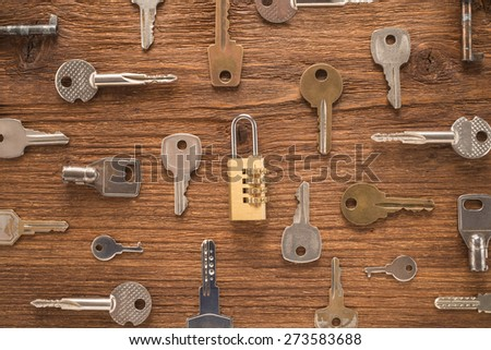 The old keys on a wooden background    - stock photo