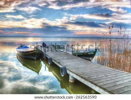 the old lake pier - stock photo