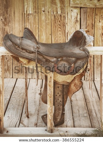 The old leather saddle for horse riding - stock photo