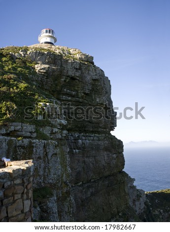 The old lighthouse at Cape Point, South Africa is a beacon that helps ships navigate around the Cape of Good Hope between the Indian and Atlantic Oceans.