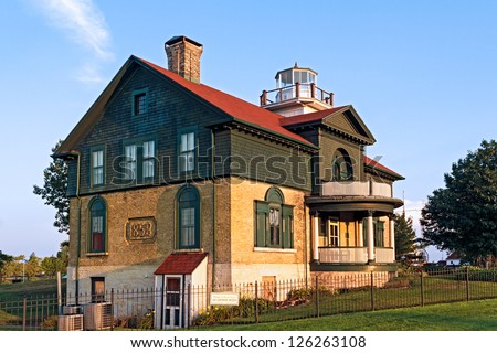 The Old Lighthouse of Michigan City, Indiana is now a museum of Lake Michigan maritime history. - stock photo