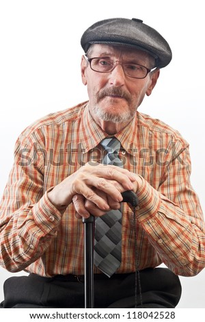 the old man in checkered shirt and glasses - stock photo
