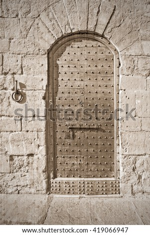 The old medieval door. Old style. Sepia