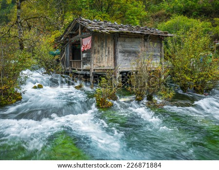 The old mill. Jiuzhaigou Valley was recognize by UNESCO as a World Heritage Site and a World Biosphere Reserve - China - stock photo