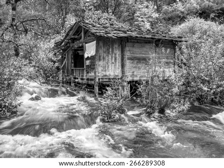 The old mill. Jiuzhaigou Valley was recognize by UNESCO as a World Heritage Site and a World Biosphere Reserve - China (black and white) - stock photo
