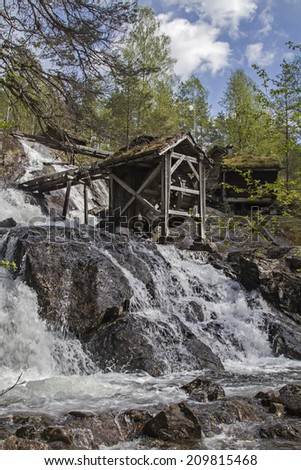 The Old Mill of Kollbeinstveit lies hidden in the forest directly at the waterfall