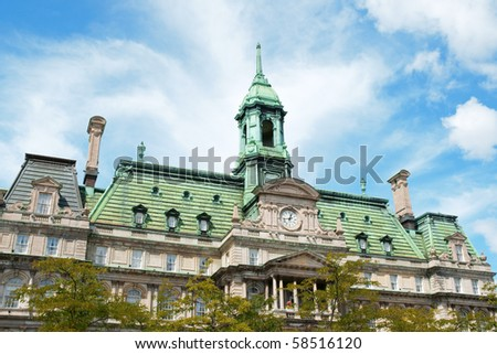 The old Montreal city hall (hotel de ville) on a cloudy day - stock photo