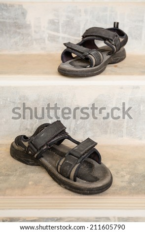 The old open-toe platform sandals on cement stair